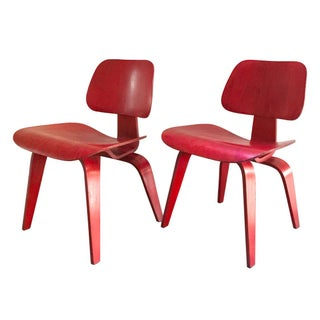 Eames Red Molded Plywood Lounge Chairs - A Pair