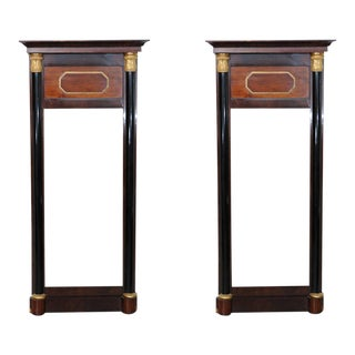 Pair of Baltic Neoclassic Mahogany Ebonized Parcel-Gilt Mirrors