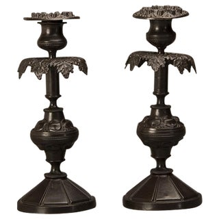 A pair of the most curiously designed bronze candlesticks from Italy c. 1900.