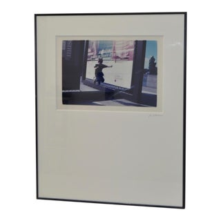 Color Photograph of Child Jumping in Front of French Museum Poster