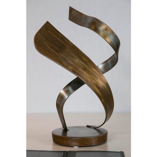 "Image of ""Attraction"" Steel Sculpture by Joe Sorge"
