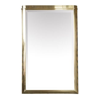 1970'S CURVED BRASS MIRROR BY THE DESIGN INSTITUTE OF AMERICA
