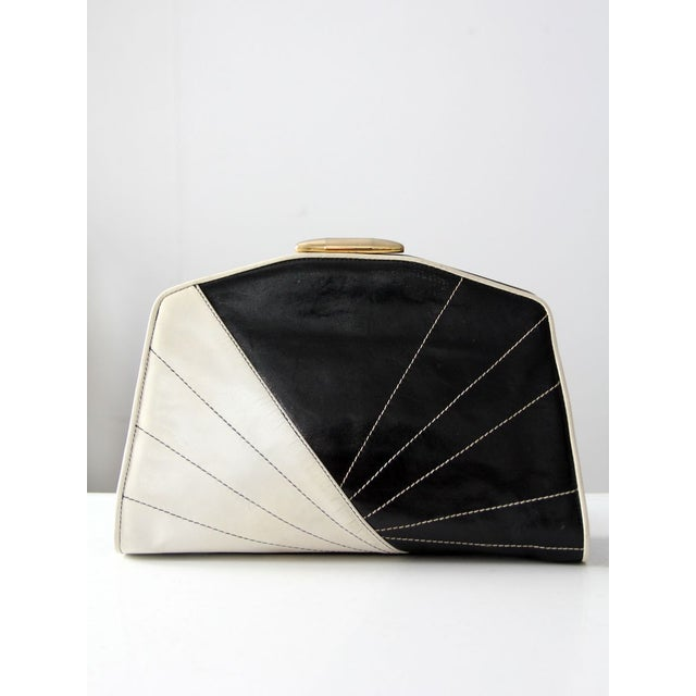 Image of 1980s black and white leather clutch
