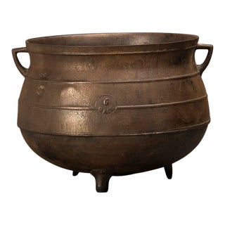 Large bronzed cast iron cauldron standing on three feet from England c.1850.