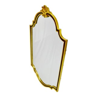 Large vintage Carolina Mirror Corporation wall mirror with burgundy and gold colored frame.