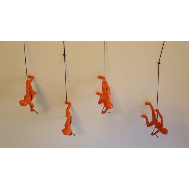 Image of Orange Climbing Man Wall Art- Set of 4