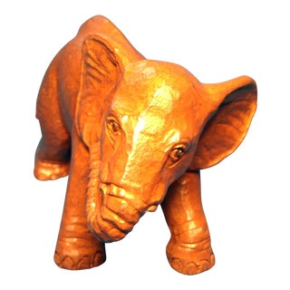 C. Butcher Pecan Resin Elephant Figure