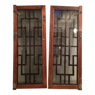 A Pair of Antique Chinese Carved Mahogany and Smoke Glass Windows
