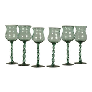 Set of six tall hand blown glass drinking vessels from France c.1875 each with a ribbon twist stem and flared rim with original pontil mark on base