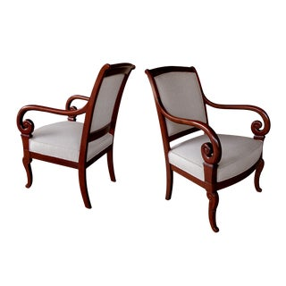 A Gracefully Proportioned Pair of French Restauration Mahogany Armchairs