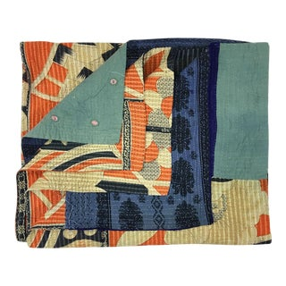 Blue and Orange Rug and Relic Kantha Quilt