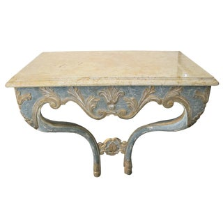 An elegant custom-made Italian baroque style aqua and ochre painted console table with marble top