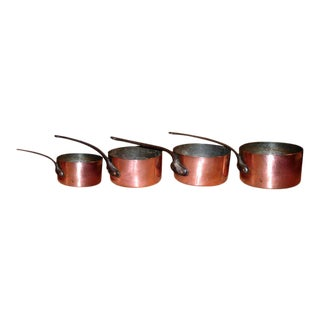 Set of Four Graduated French Iron and Copper Pots