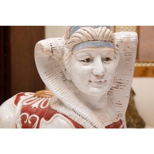 Image of Pair of Glazed Terra Cotta Sphinx Figures
