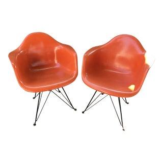 Vintage Orange Eames Fiberglass Chairs - A Pair