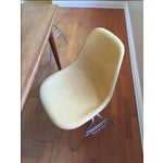 Image of Vintage Yellow Eames Shell Chairs - Set of 4