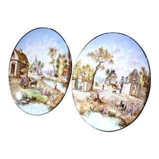 Early 20th Century French Hand-Painted Faience Wall Plates - A Pair