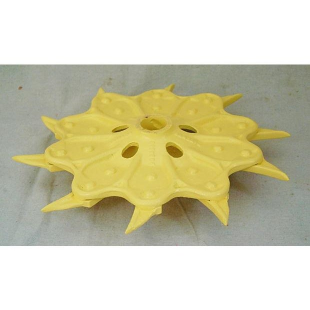 Image of Vintage Yellow Industrial Iron Cultivator Wheel