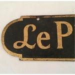 Image of Le Petite Gourmet Restaurant Sign