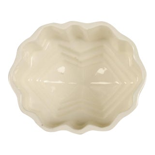An oval glazed earthenware jelly mould featuring an octagonal pattern from Great Britain c.1880