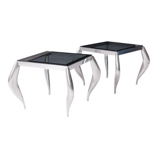 A pair of wavy legged end tables in the style of Jordan Mozer
