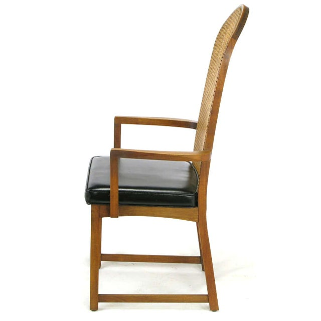 Image of Four Milo Baughman Walnut & Cane Arch-Back Dining Chairs