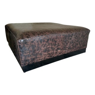Gambrell Renard Distressed Leather Ottoman