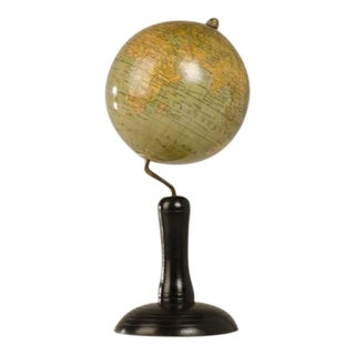 A terrific small world globe mounted on a black painted stand with a metal arm from Germany c.1950