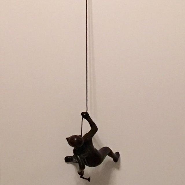 Image of Hanging Black Climbing Man