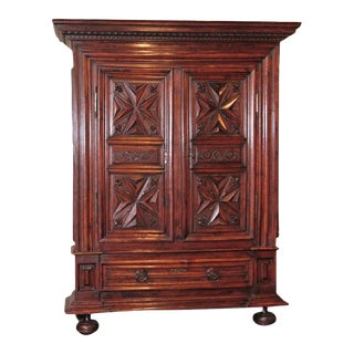 Late 17th Century French Louis XIII Carved Walnut Armoire With Fleur-De-Lys
