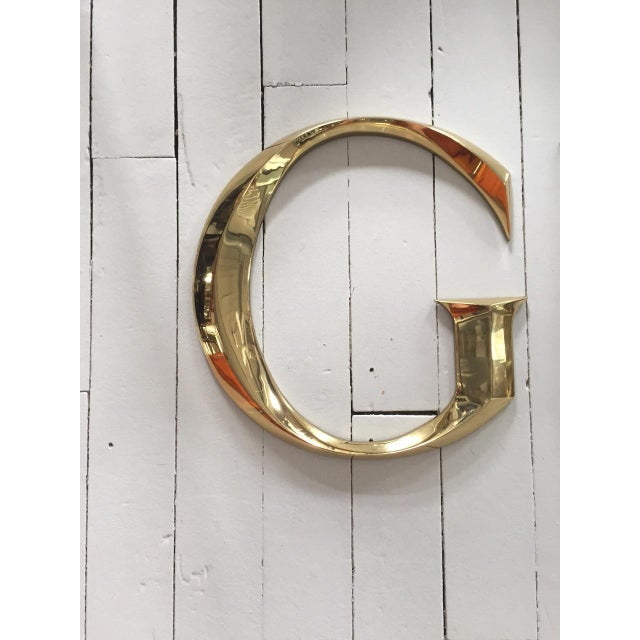 "Image of Brass Letters Spelling ""GUCCI"""