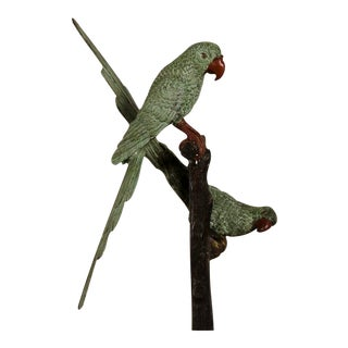 A pair of life size parrots made of bronze perched on a stand with the original finish from Austria c.1890