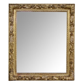 A Deeply Carved Italian Neoclassical Style Giltwood Mirror