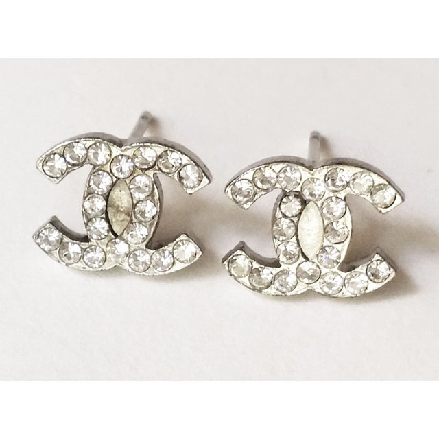 Image of Authentic Chanel Silver Mini CC Pierced Earrings