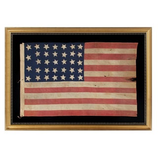 34 STARS, AN ENTIRELY HAND-SEWN CIVIL WAR PERIOD FLAG IN AN EXTRAORDINARY SMALL SIZE FOR THE PERIOD, 1861-63, KANSAS STATEHOOD
