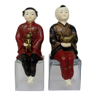 Porcelain Shelf-Sitters, a Pair