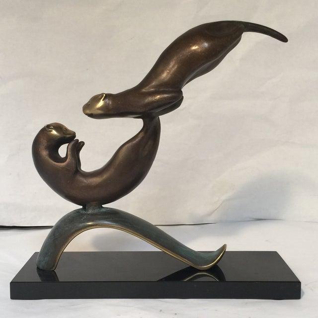 Image of Otter Bronze Sculpture on Granite Base