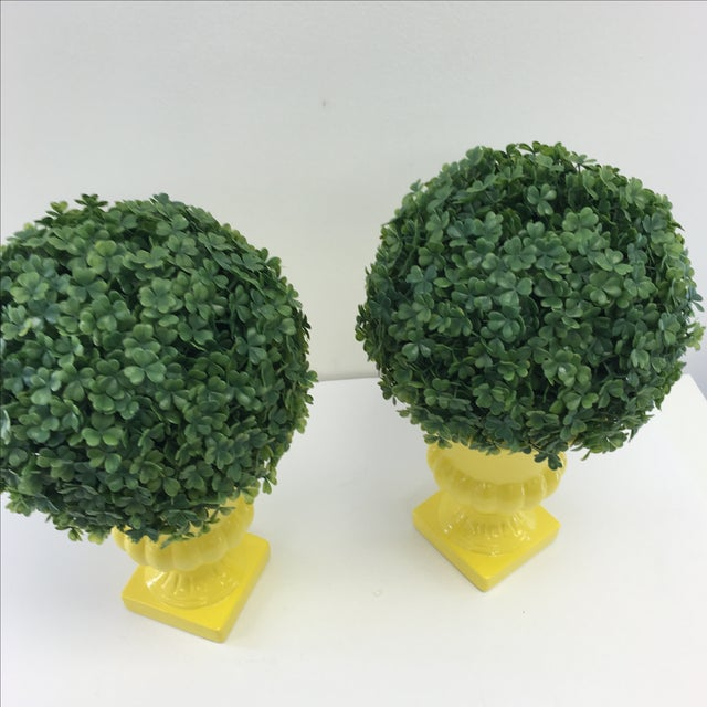 Image of Faux Boxwoods in Yellow Urns - Pair