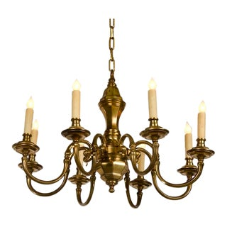 An unusual eight arm brass chandelier with a geometric profile from Holland c.1920.