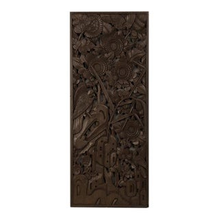 A handsome carved timber panel featuring a stylized landscape with birds and foliage from China c.1900