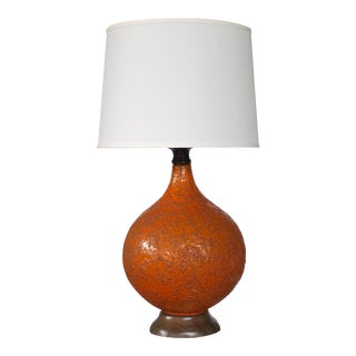 A large and iconic American 1960's burnt-orange crater-glazed ceramic lamp