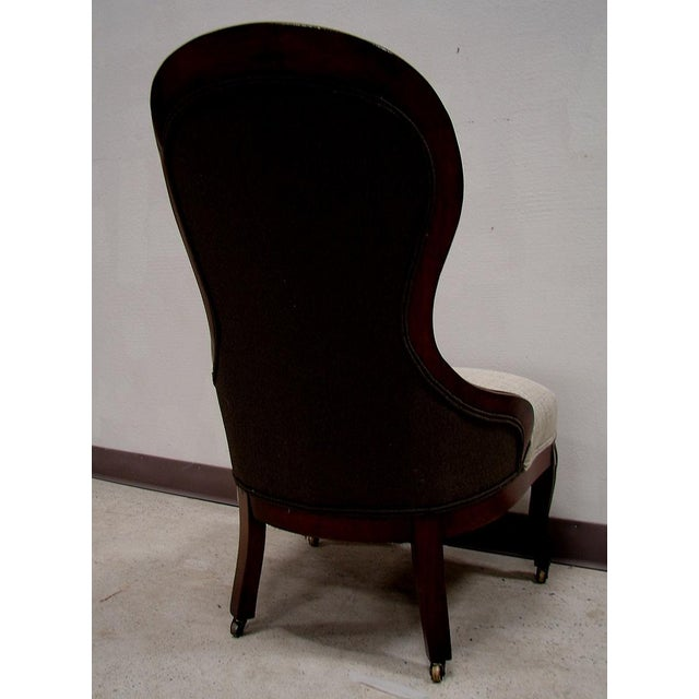 Image of Antique Upholstered Chair on Castors