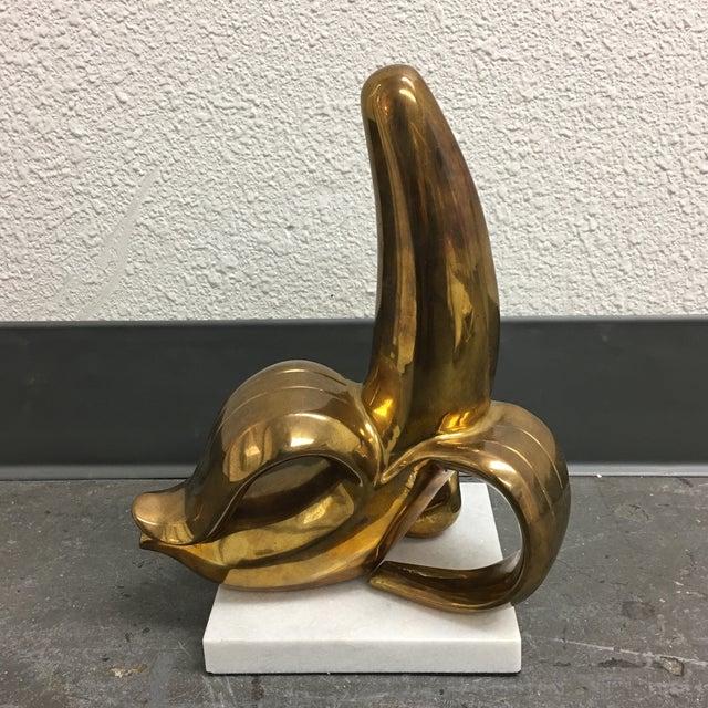 Jonathan Adler Brass Banana Sculpture on a White Marble Base - Image 2 of 7