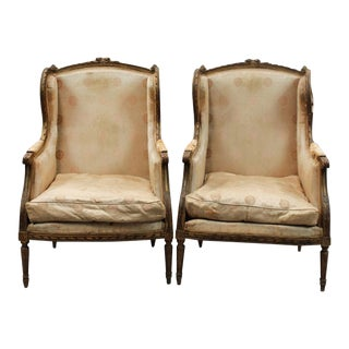 A Pair of Louis XV French Bergere Chairs With Gilt Finish