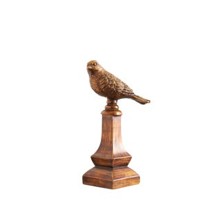 Small Bird on a Pedestal