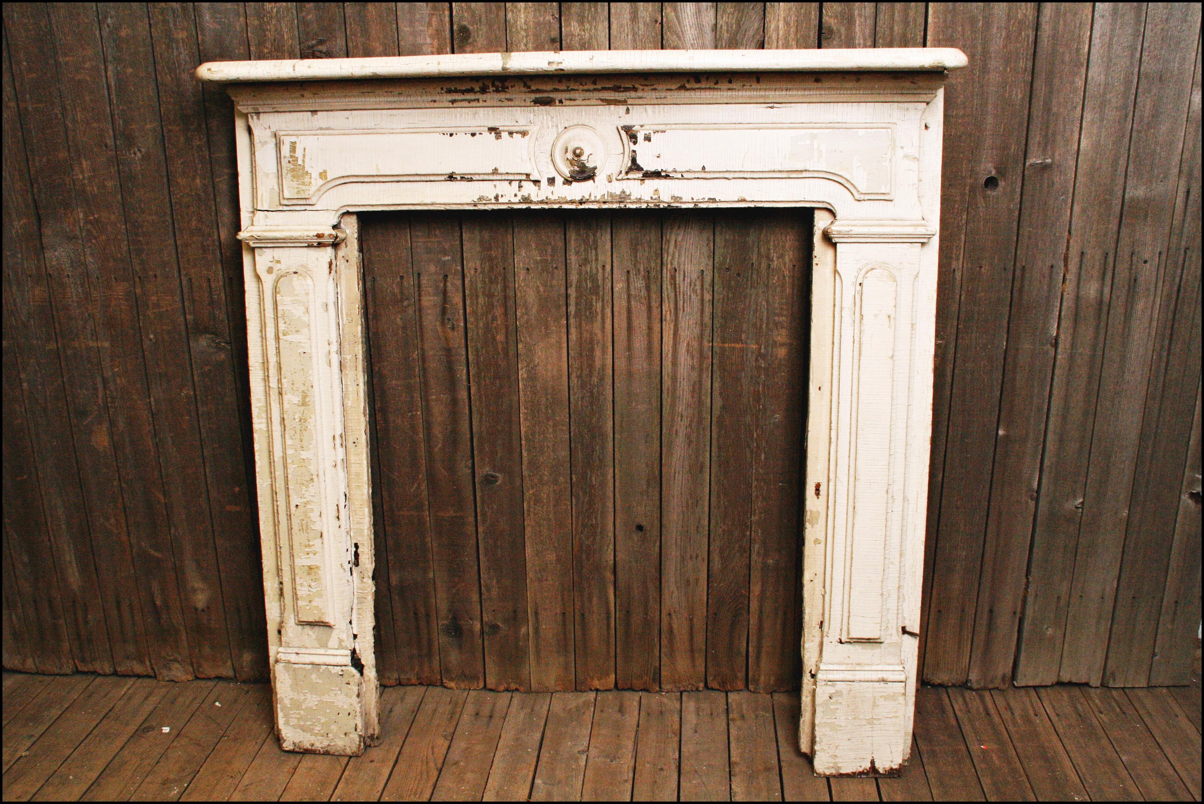 image of antique white wood fireplace mantel
