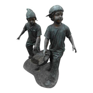 Bronze Statue of Two Boys Holding a Bowl