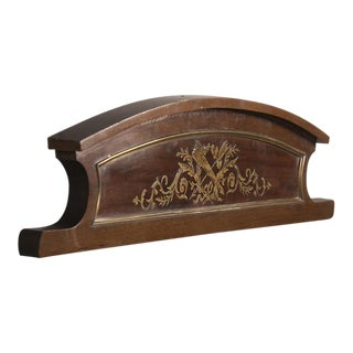 A fragment from a bibliothèque made of mahogany inlaid with brass from France c. 1860.