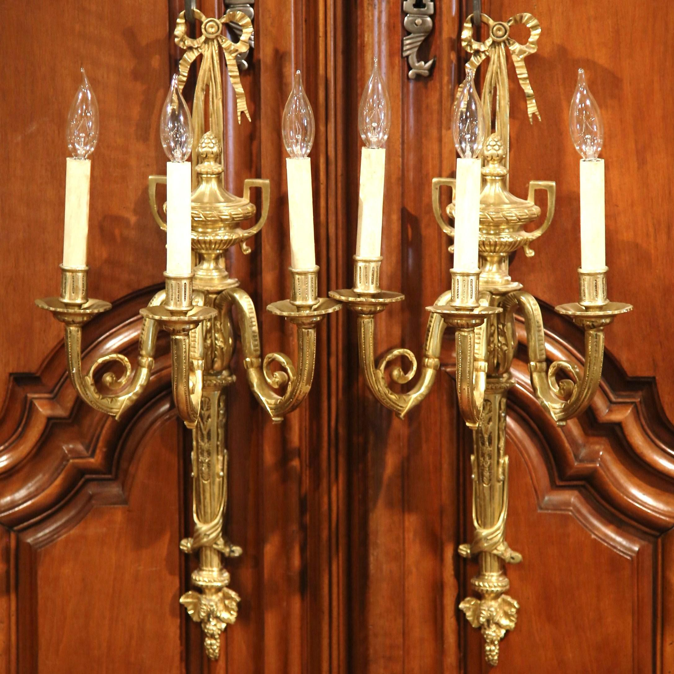 pair of early 20th century french louis xvi threelight bronze wall sconces image