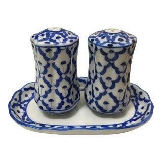 Blue & White Salt & Pepper Shakers on Plate